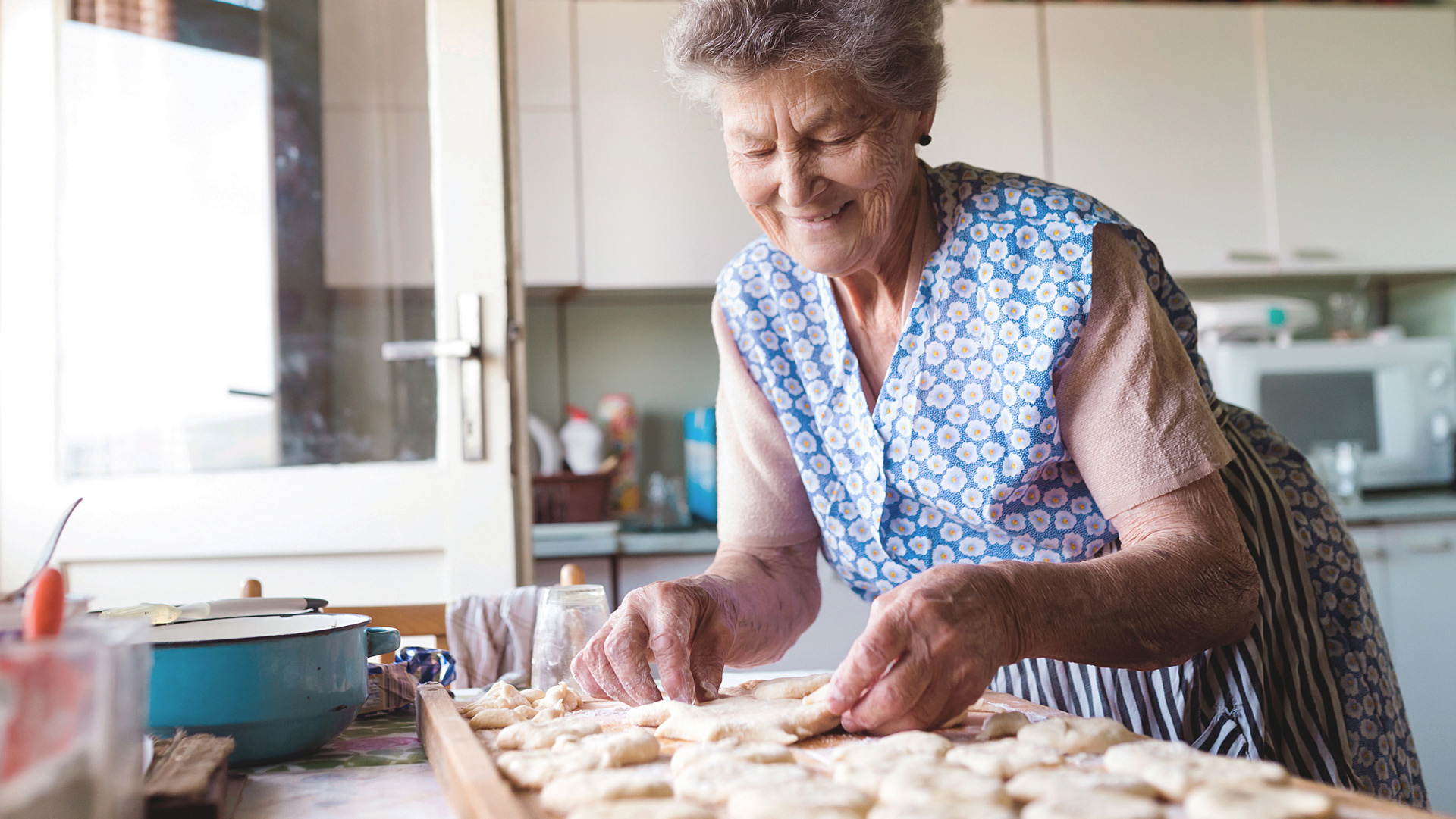 Senior woman making food
